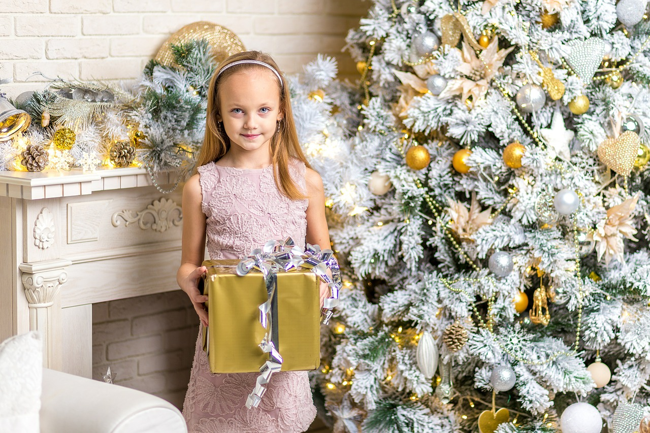 young pretty girl with gold wrapped gift for holiday4 gift rule