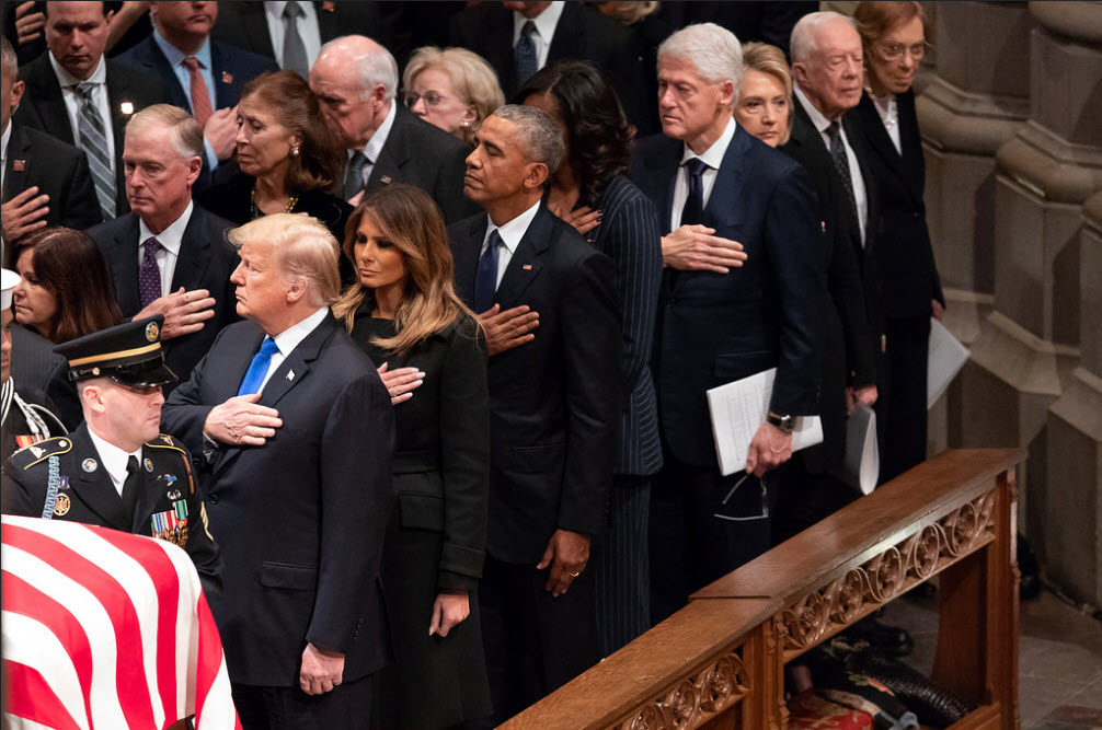 donald trump hand over heard during george bush funeral fake news
