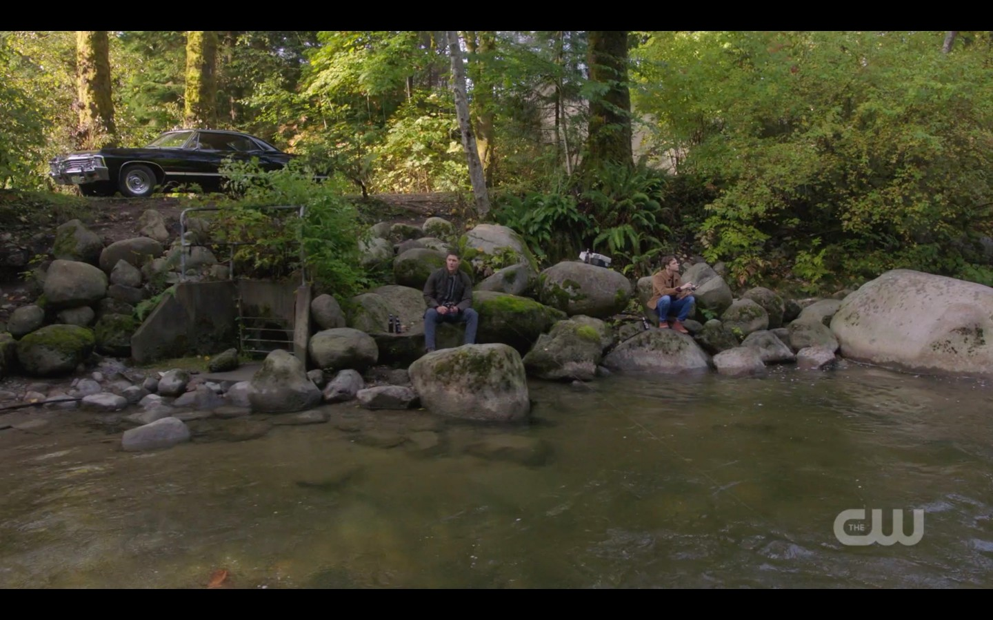 jack and dean winchester on rocks at river spn 1407