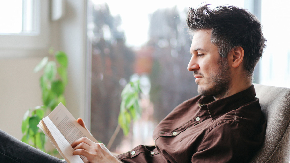 man reading a book self care gifts