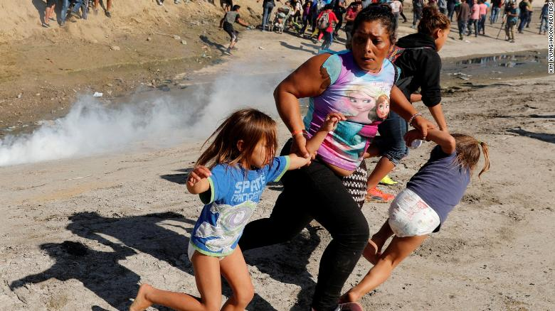 migrant woman fleeing with two children not fake news