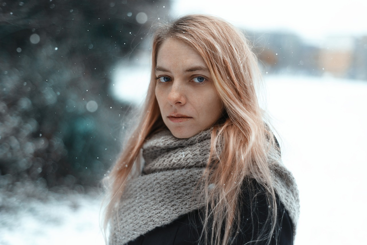 young woman in snow feeling sad symptoms