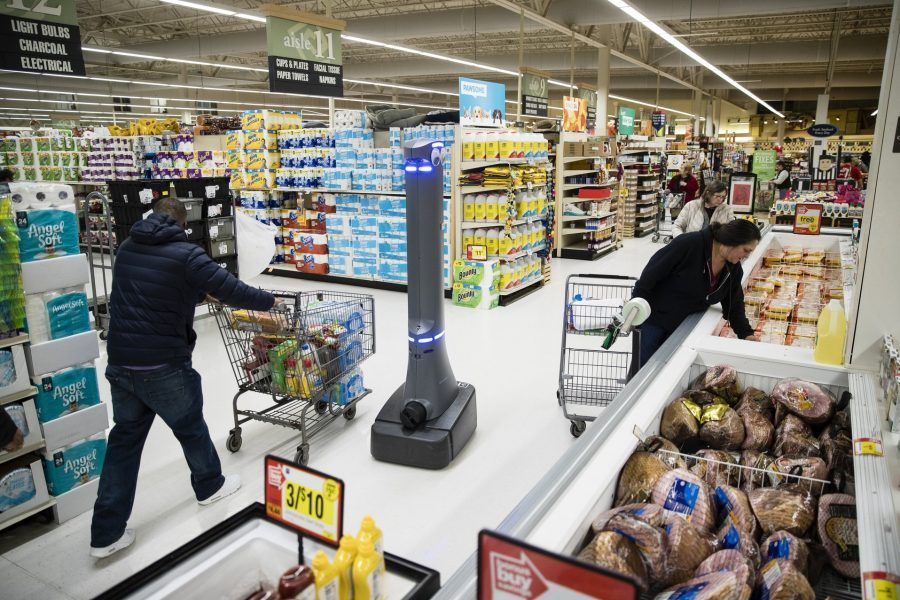 robot marty cleaning floors at giant grocery store ai