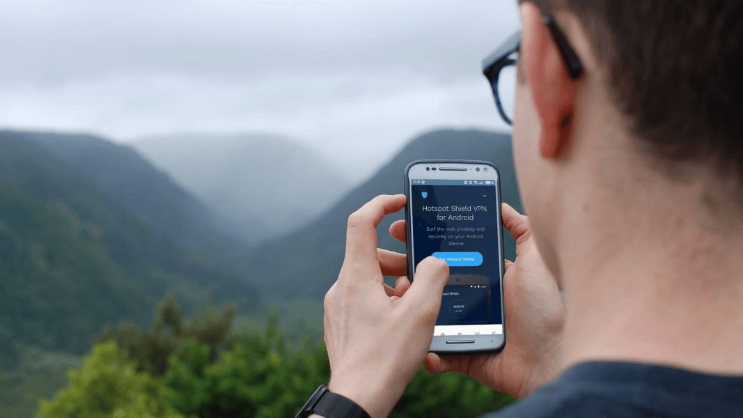 hotspot shield with man outside using wifi