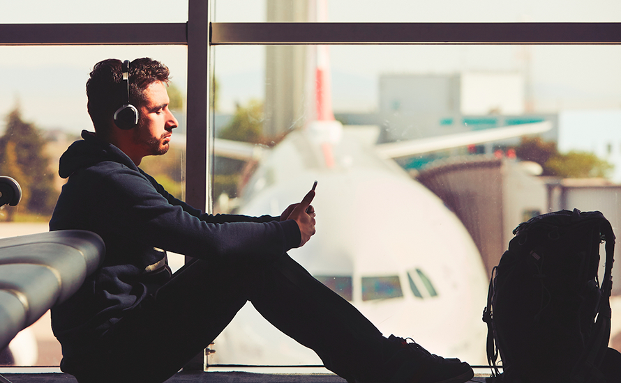 man using wifi at airport unknown hackers