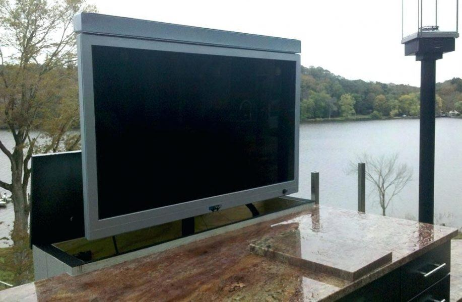 tv lift cabinet outside by the lake
