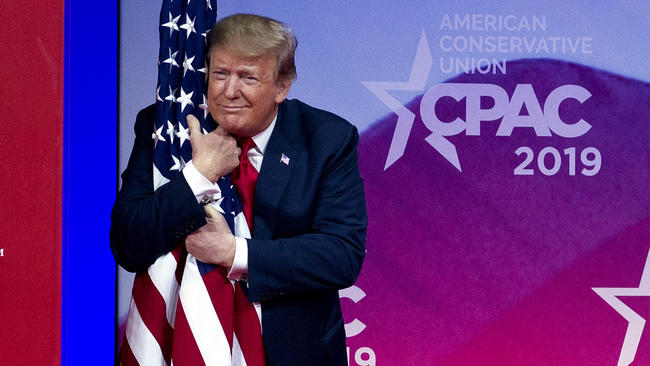 donald trump hugging american flag at cpac