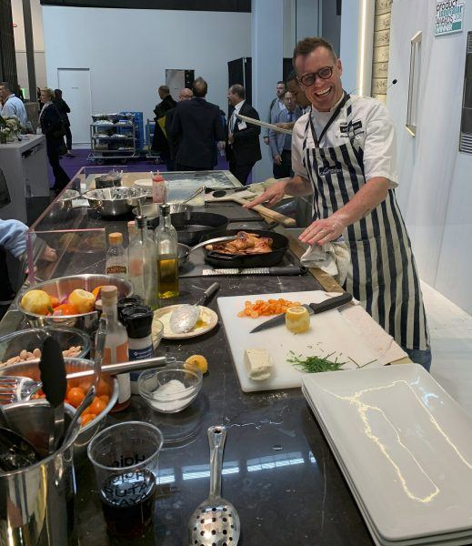 Brian Malarkey shows off ge induction appliances for hi tech kitchens