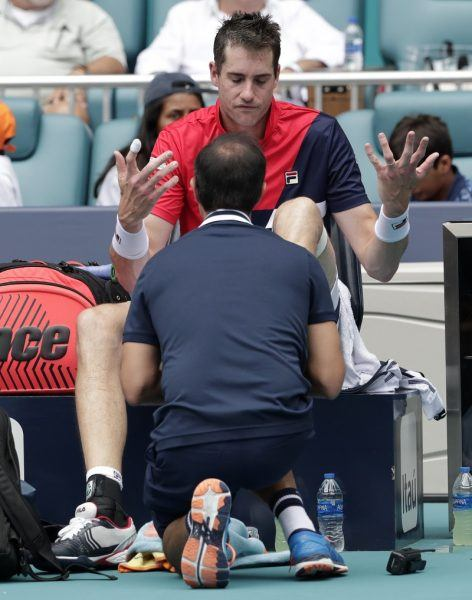 John Isner frustrated by injury at 2019 Miami Open losing to Roger Federer.