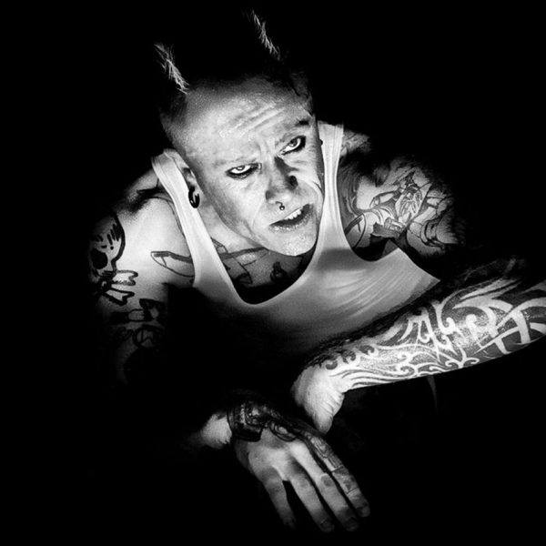 Keith Flint of Prodigy looking up with horns.
