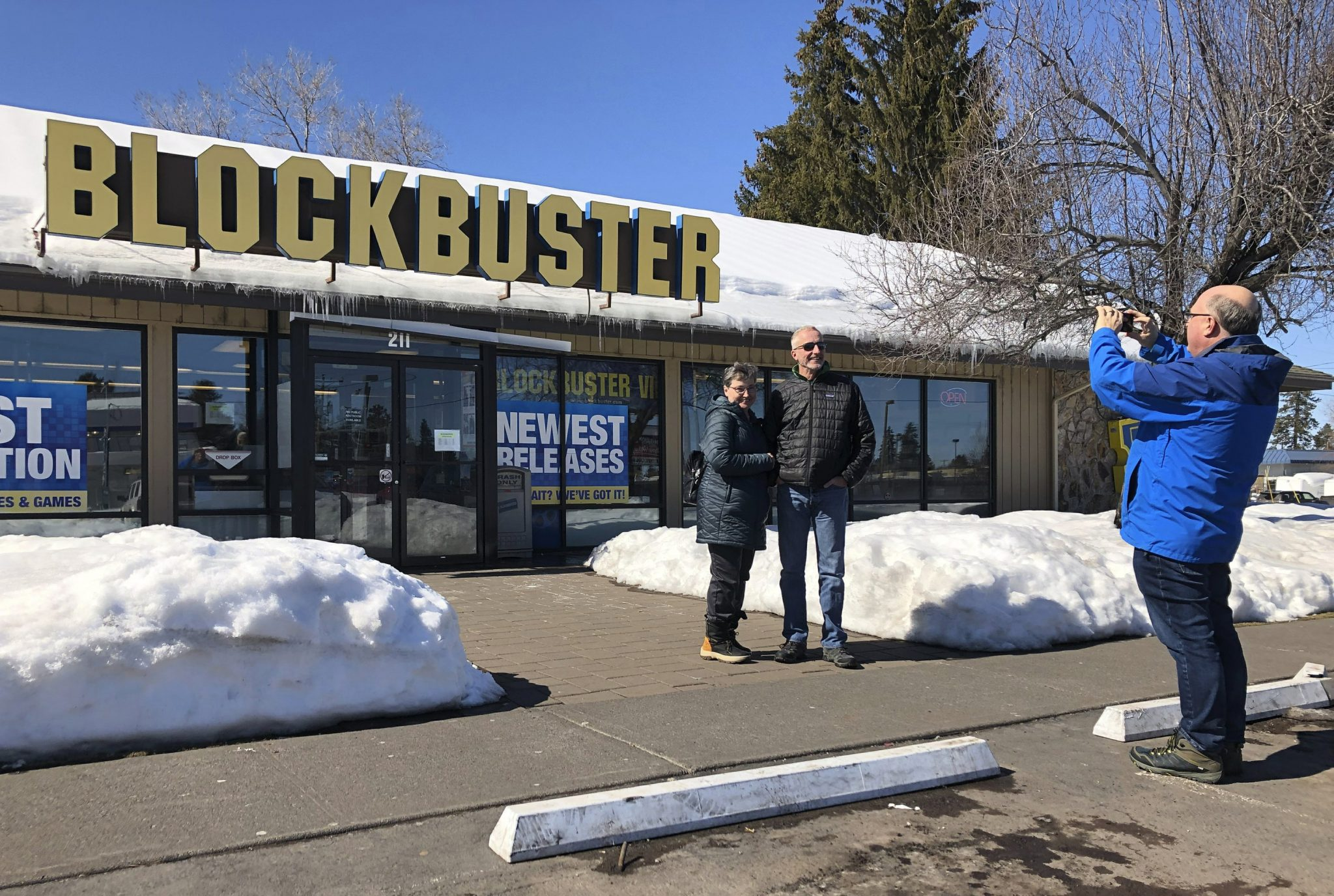 Owners Debby Saltzman with twin brother Michael Trovato pose in front of last Blockbuster store on Earth.