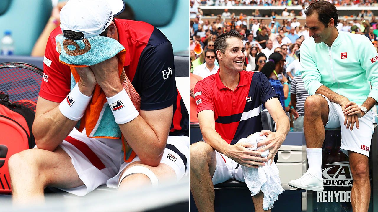 Roger Federer checking on John Isner injury after beating him at 2019 Miami Open.