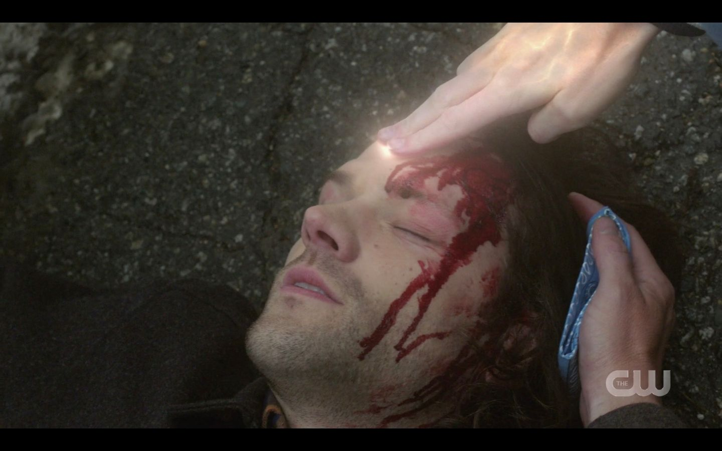 Dean Winchester holding cloth to Sams bloody head SPN 14.17