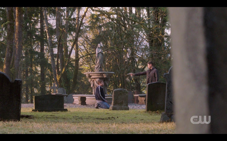 Dean Winchester pointing gun at Castiel in cemetary SPN 14.20