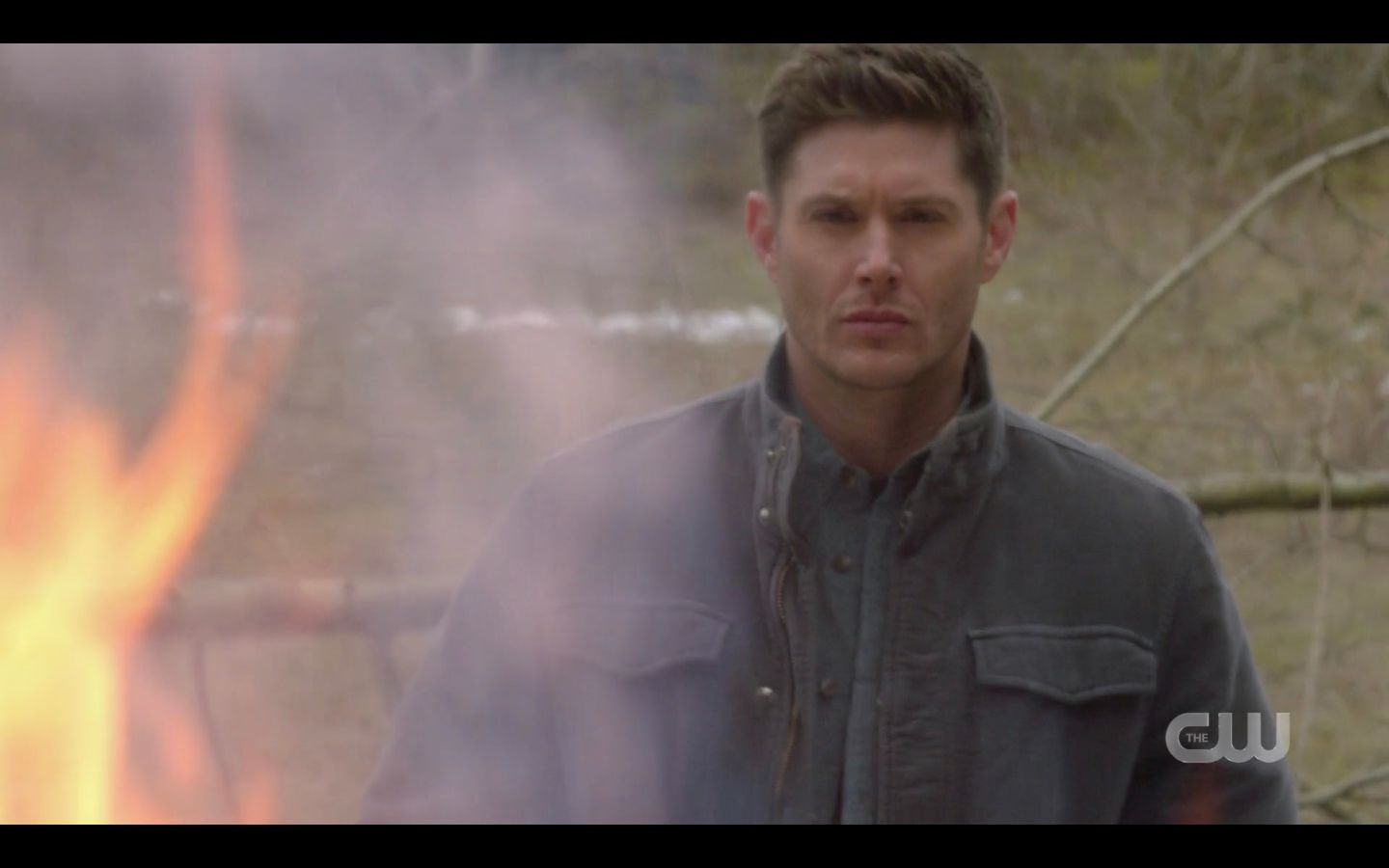 Dean Winchester stands stoicly watching hunters funeral pyre burn SPN 14.18.