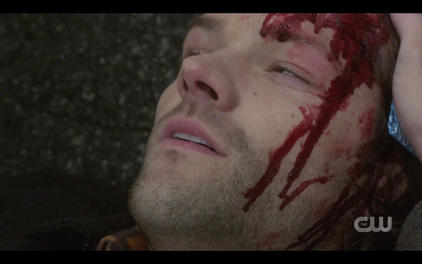 Dean caressing Sam Winchesters bloody head SPN 14.17