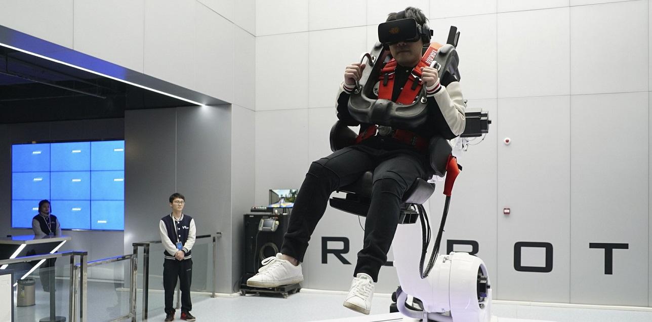 Man riding virtual reality roller coaster in VR theme part at nanchang china