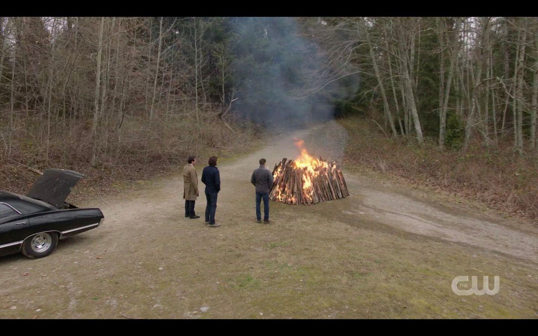 Sam Dean Winchester with castiel as bonfire burns Supernatural Absence