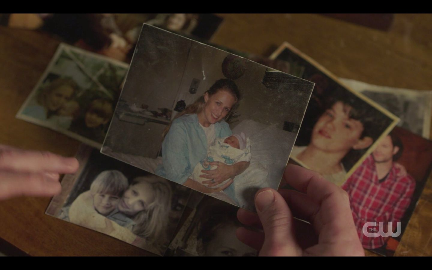 Sam WInchesters with photos of baby Sam and Dean SPN Absence