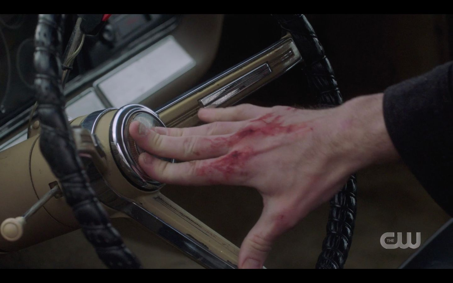 Sam Winchester bloody fingers pushing Baby horn for Dean SPN 14.17
