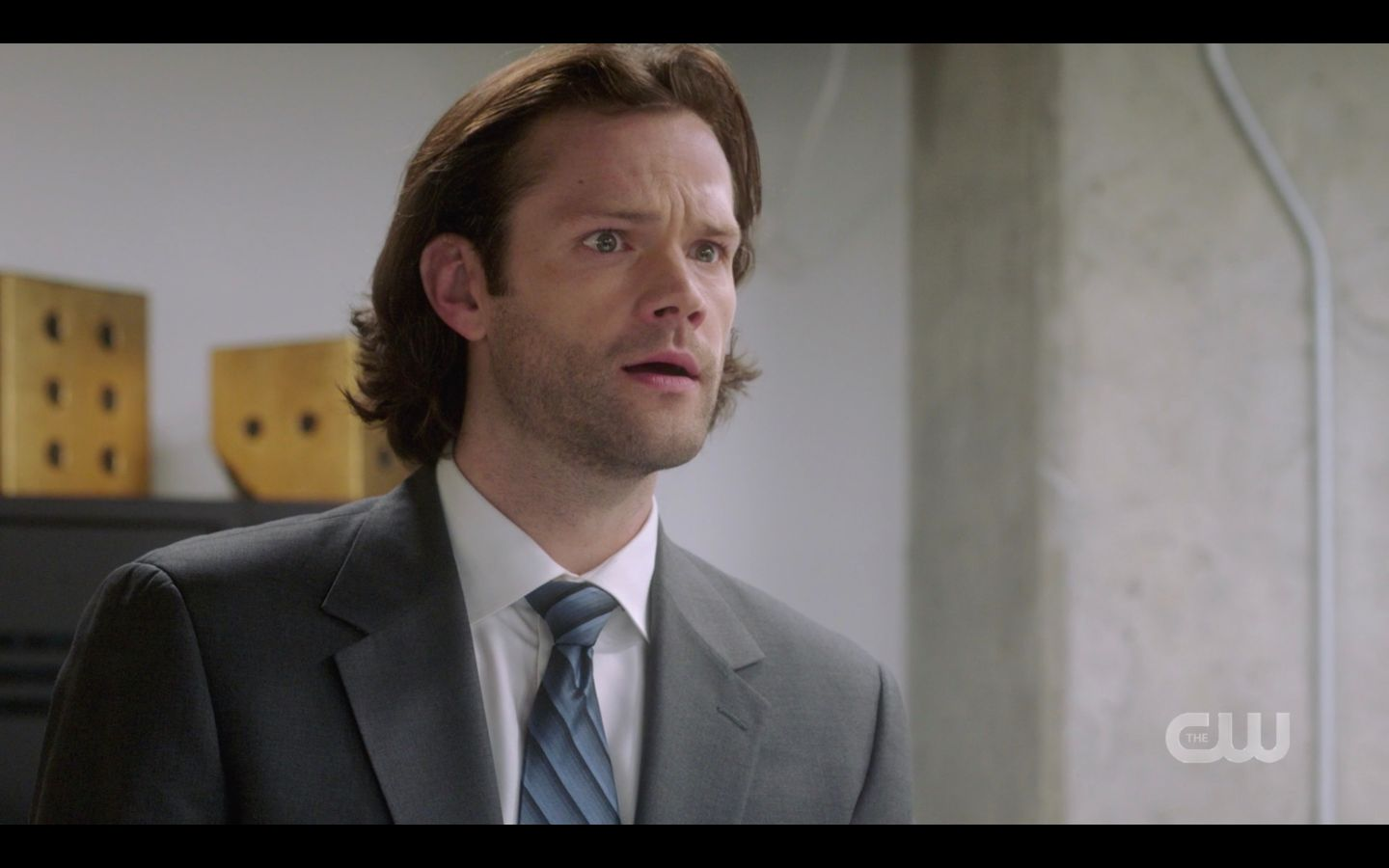 Sam Winchester suited up with Dean in office SPN 14.20