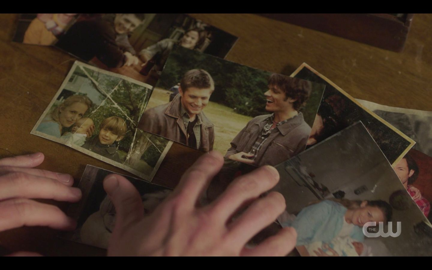 Sam Winchester with old photos of him and dean with Mary SPN 14.18