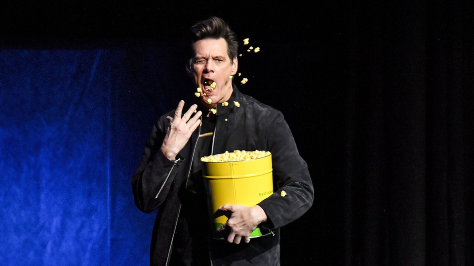 Jim Carey throwing popcorn at CinemaCon for Sonic movie.