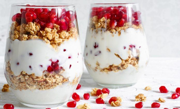 pomegranite fruit with yoguart granola healthy alternative to cereal 2019 images