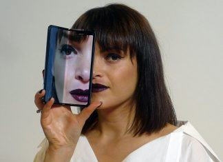samsung galaxy fold with model holding close to face images