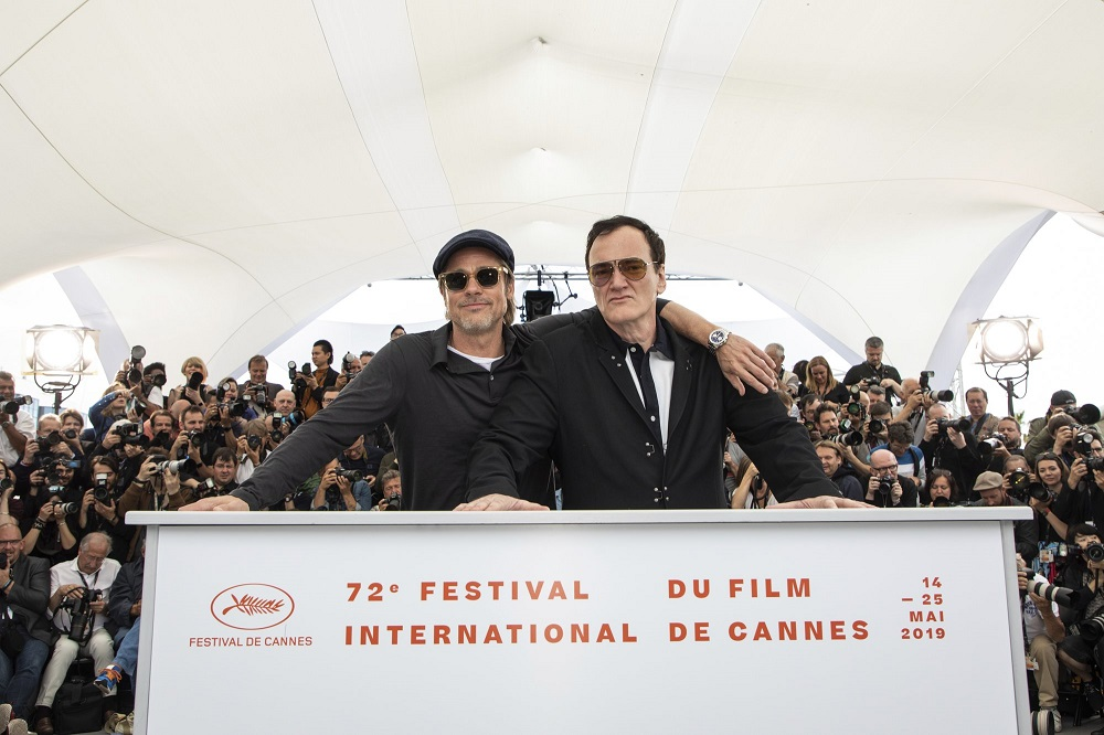 brad pitt poses with quentin tarantino at cannes once upon a time in hollywood