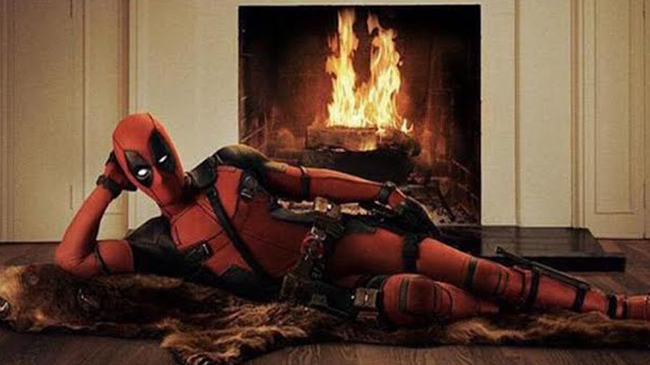 deadpool in front of hot fireplace burning