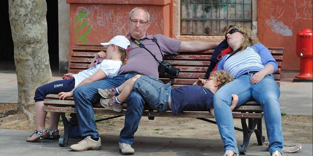 entire family with kids exhausted sleeping on bench symptoms 2019 images