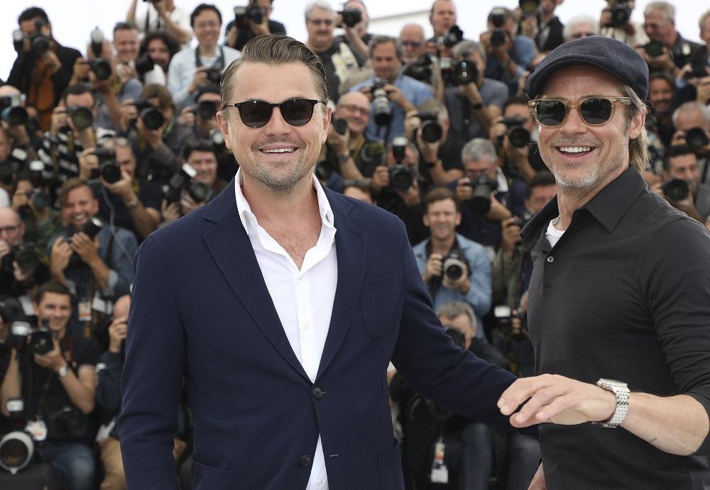 leonardo dicaprio smiles with brad pitt at cannes once upon a time