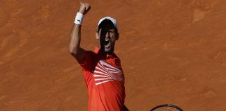 novak djokovic celebrates beating dominic thiem at madrid open 2019 images