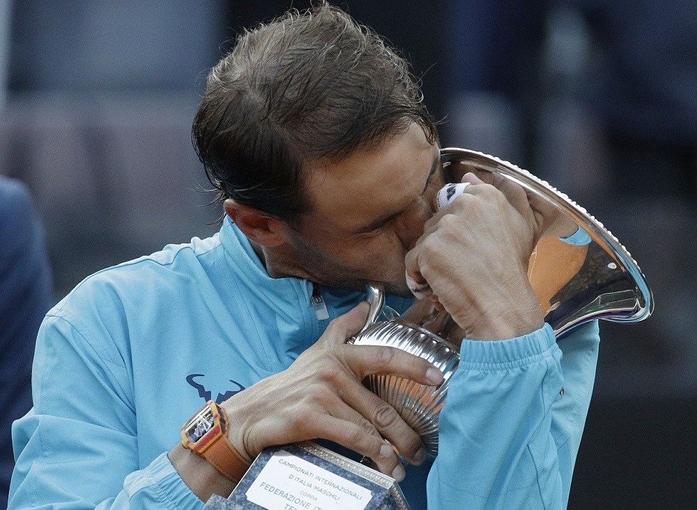 rafael nadal kisses italian open trophy beating djokovic 2019