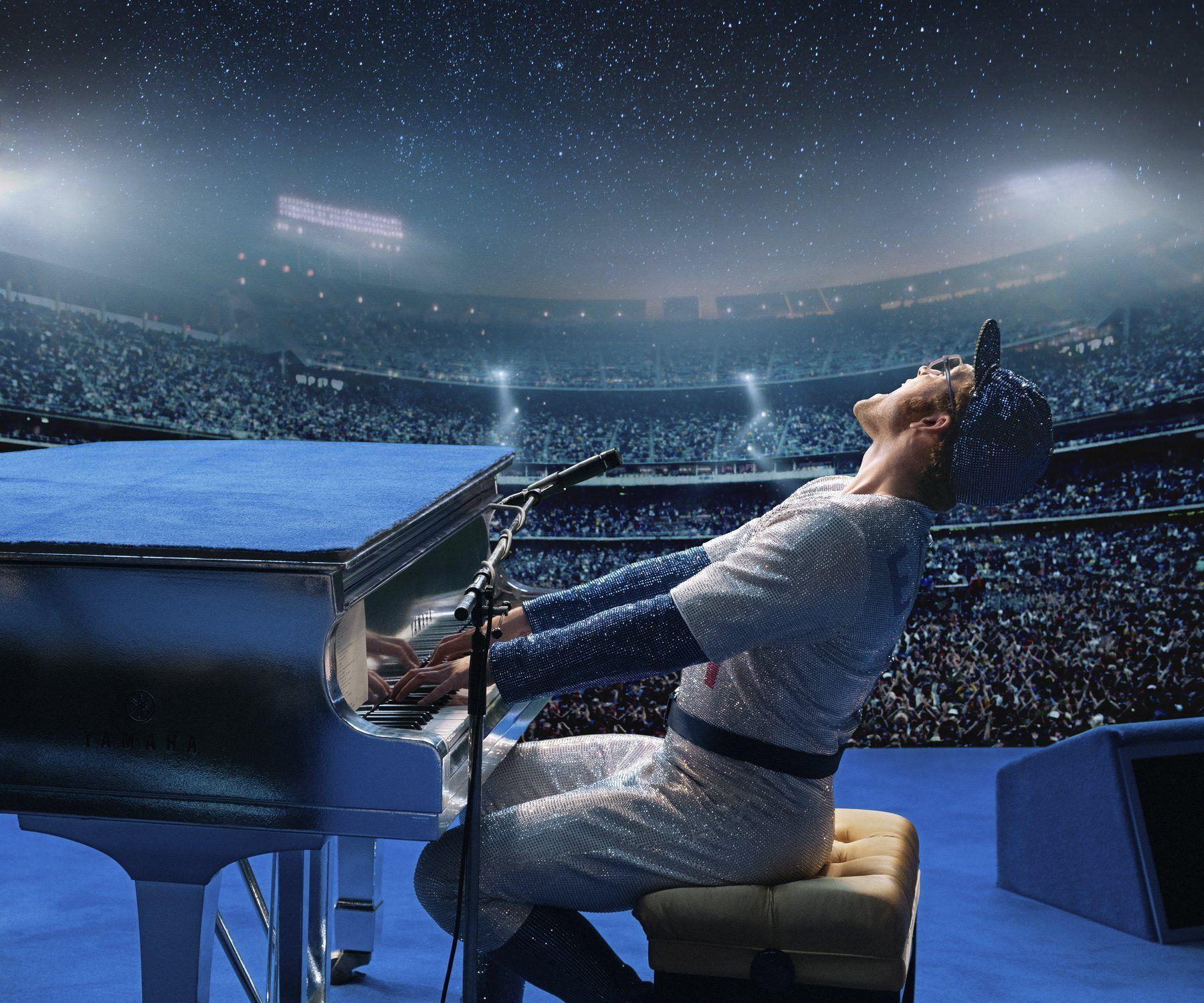 taron egerton elton john playing piano in baseball drag 2019 images