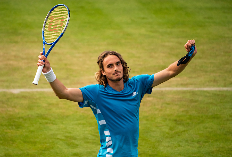 STEFANOS TSITSIPAS arms up for victory at Wimbledon 2019.