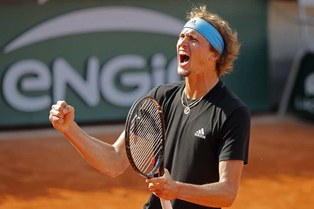 alexander zverev cheers winning against novak djokovic french open