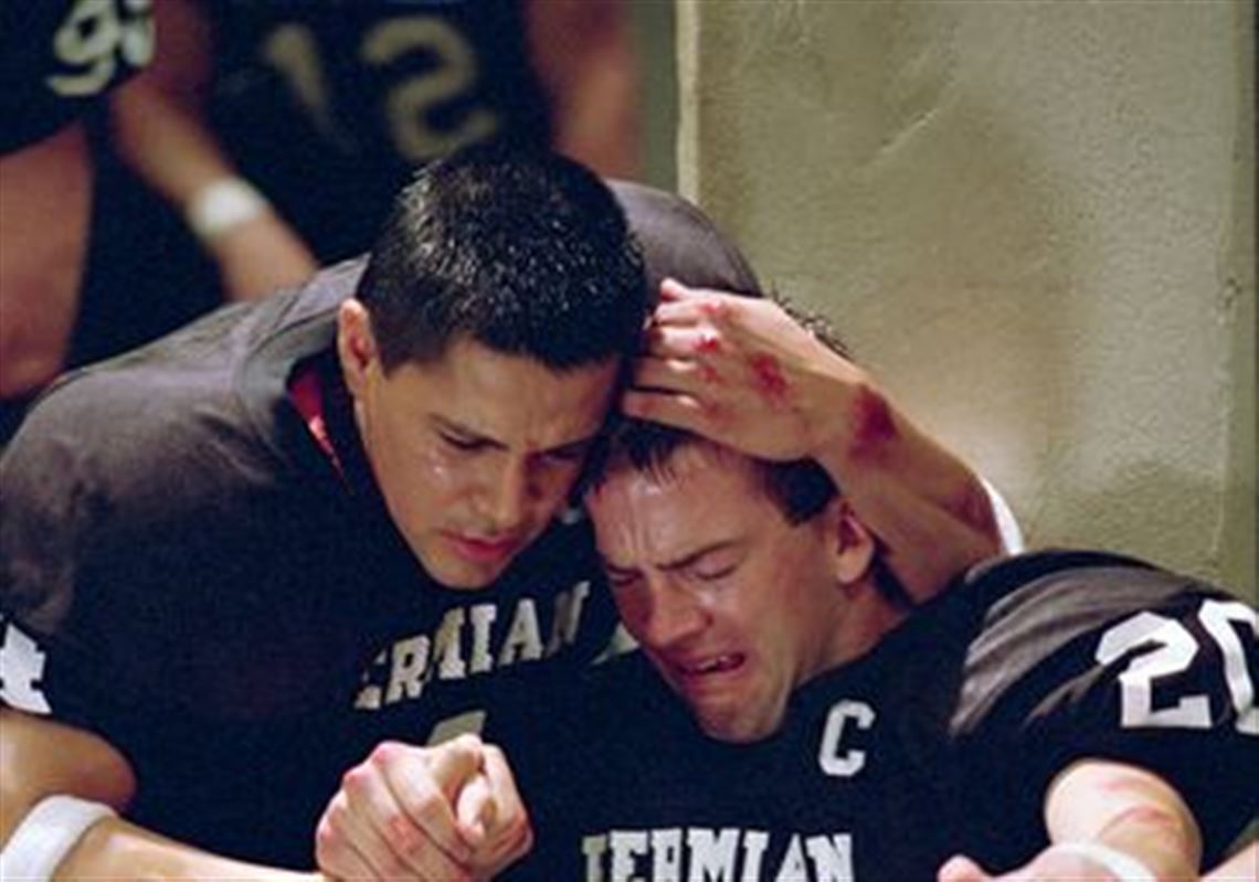 friday night lights lucas black with jay hernandez holding each other