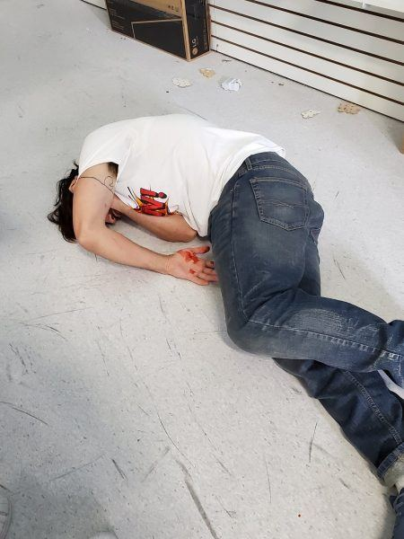 man bleeding out on floor of comic con 2019 for the boys