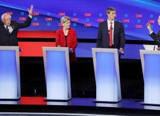 democratic debate 2 bernie sanders raising hands 2019 images