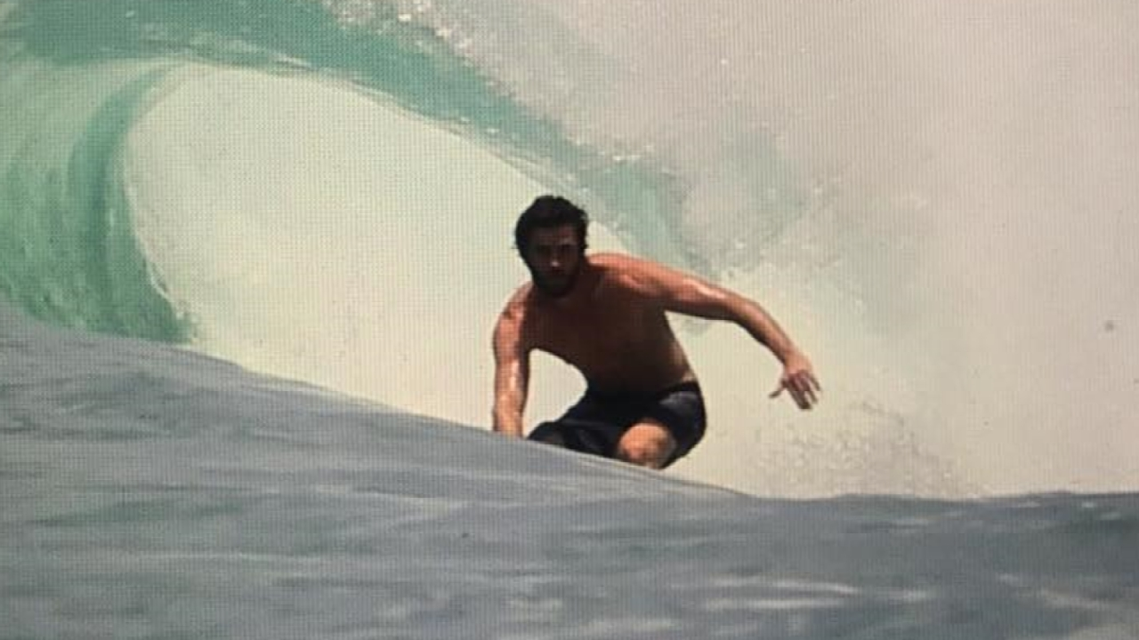 liam hemsworth surfing tight suit 2019