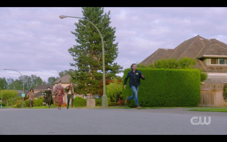 Sam Winchester running for border from Belphigor clown
