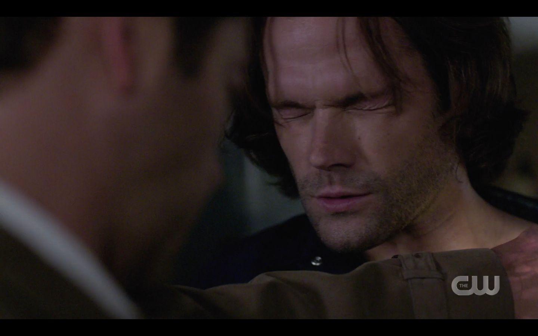 Sam Winchester squeezing eyes shut with Castiel help