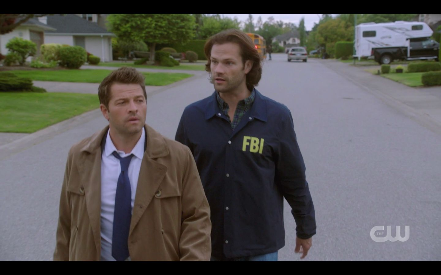 Sam Winchester with Cas searching for Dean with clown