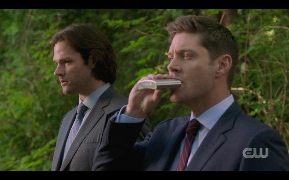 Dean Winchester taking drink from flask in front of Sam SPN 1504
