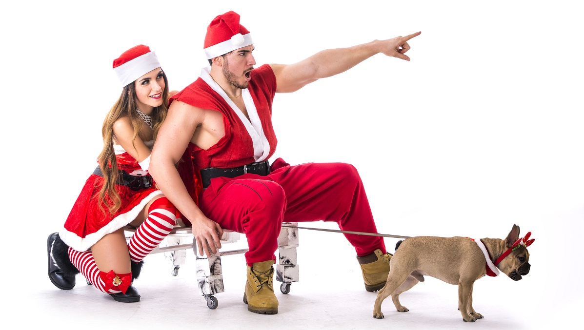 Sexy Man woman in santa outfits with pug dog leading sleigh mttg