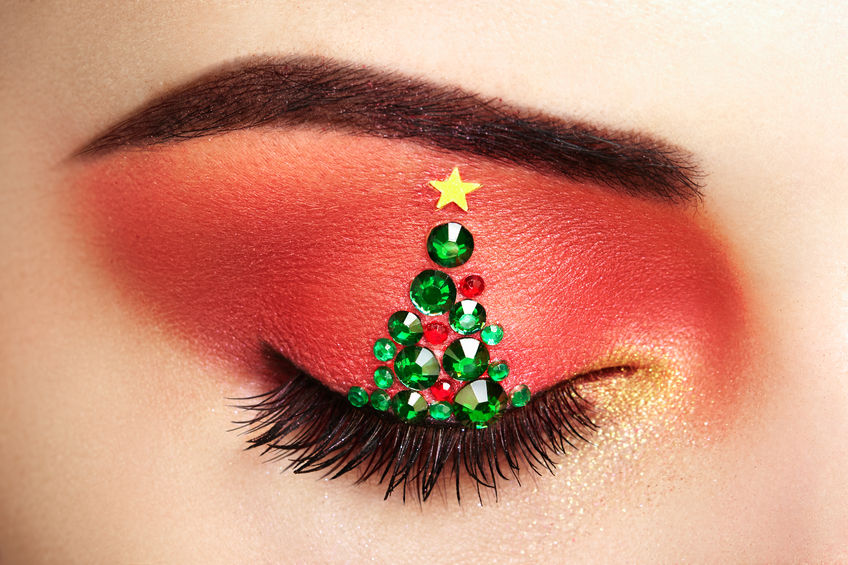 womans eye with christmas tree jewels star with eyeliner