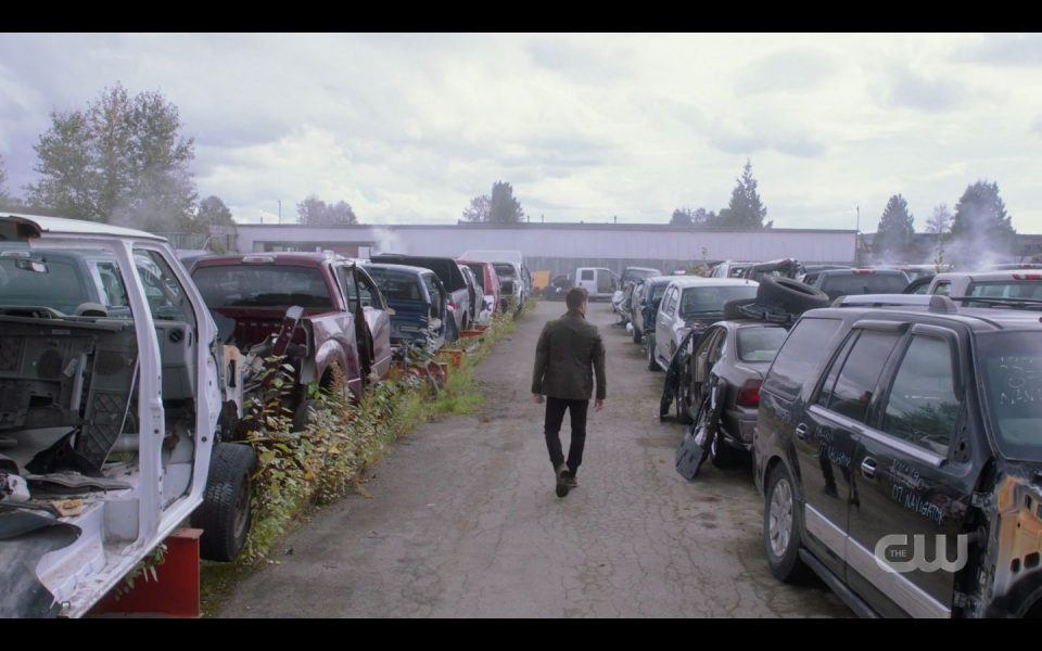 Dean Winchester walking up car scrap heap piles with Christian Kane Lee