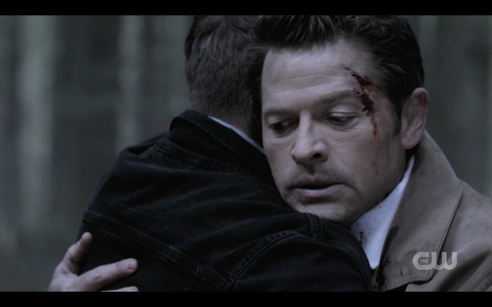 Bloody Castiel reacts to Dean Winchester hugging him in woods SPN